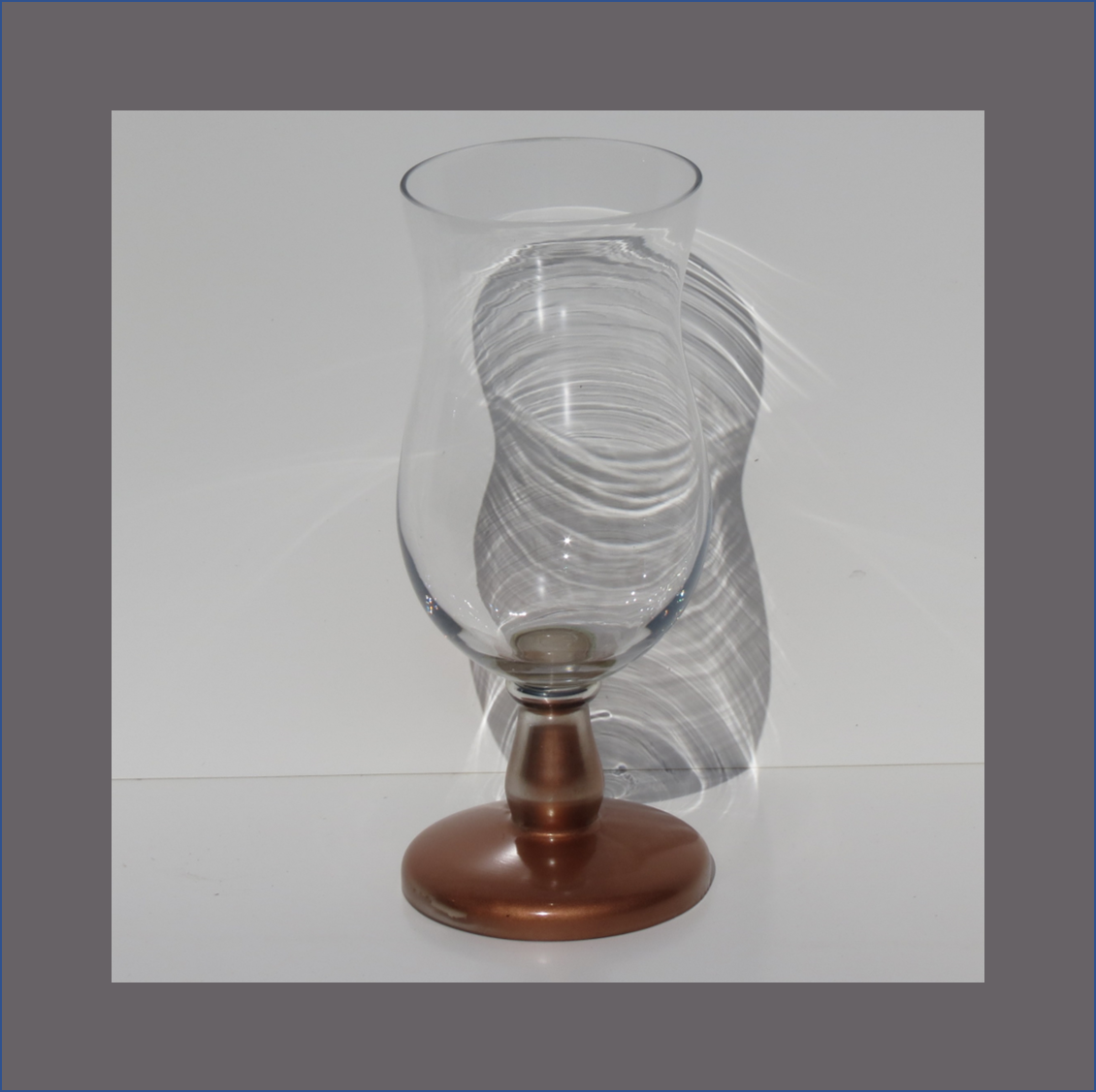 hurrican-glass-vase-with-copper-foot
