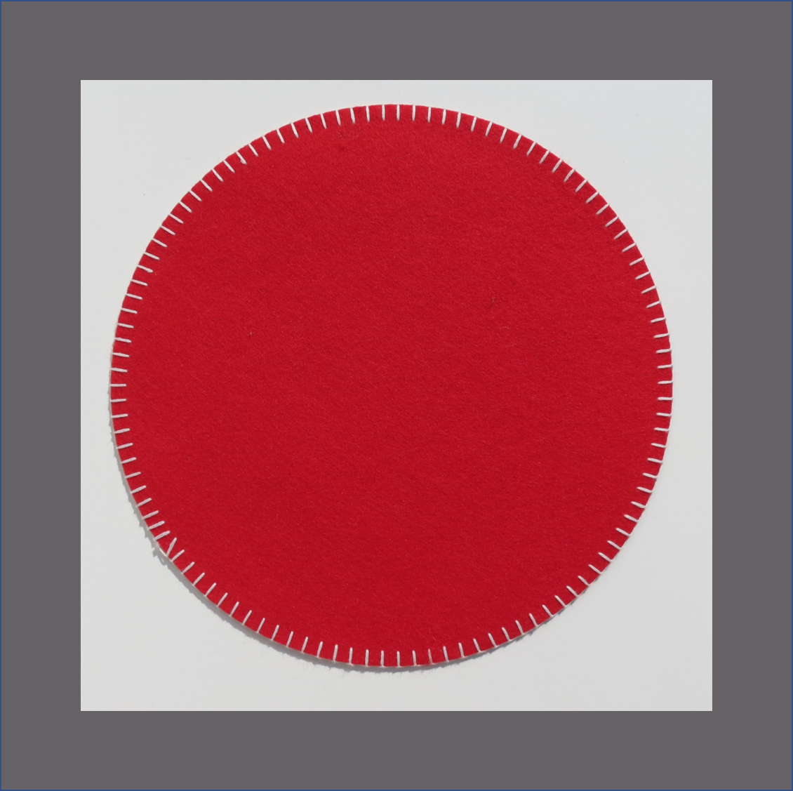 red-round-placemat-with-white-stitch-felt