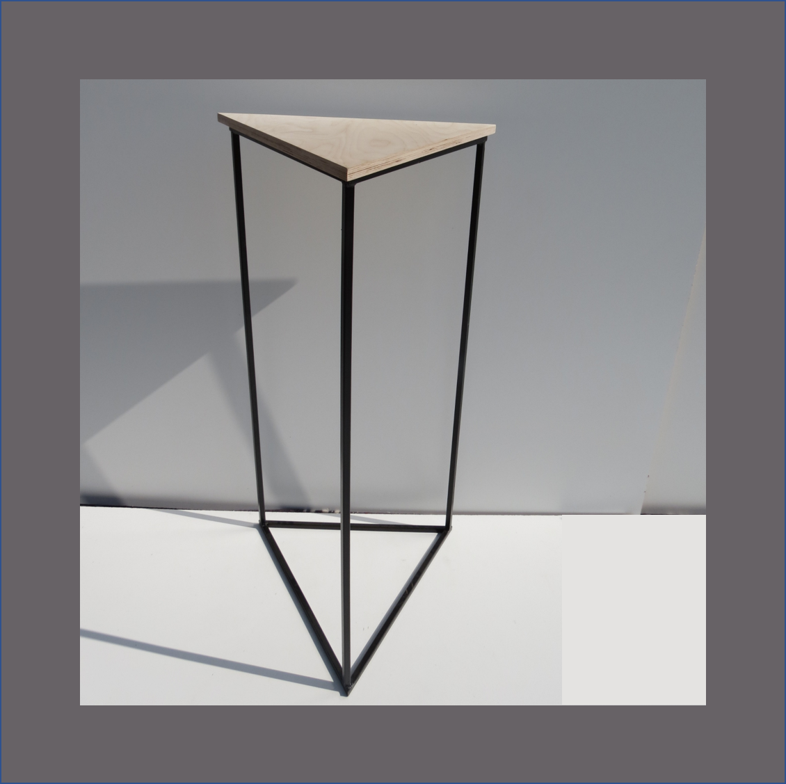 triangle-cocktail-table