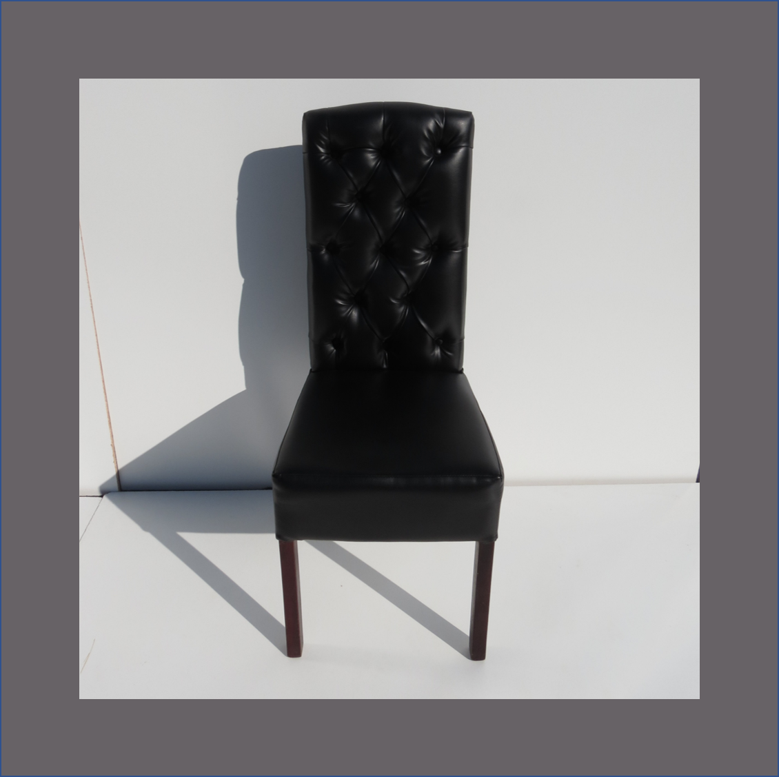 black-deep-buttoned-dining-chair